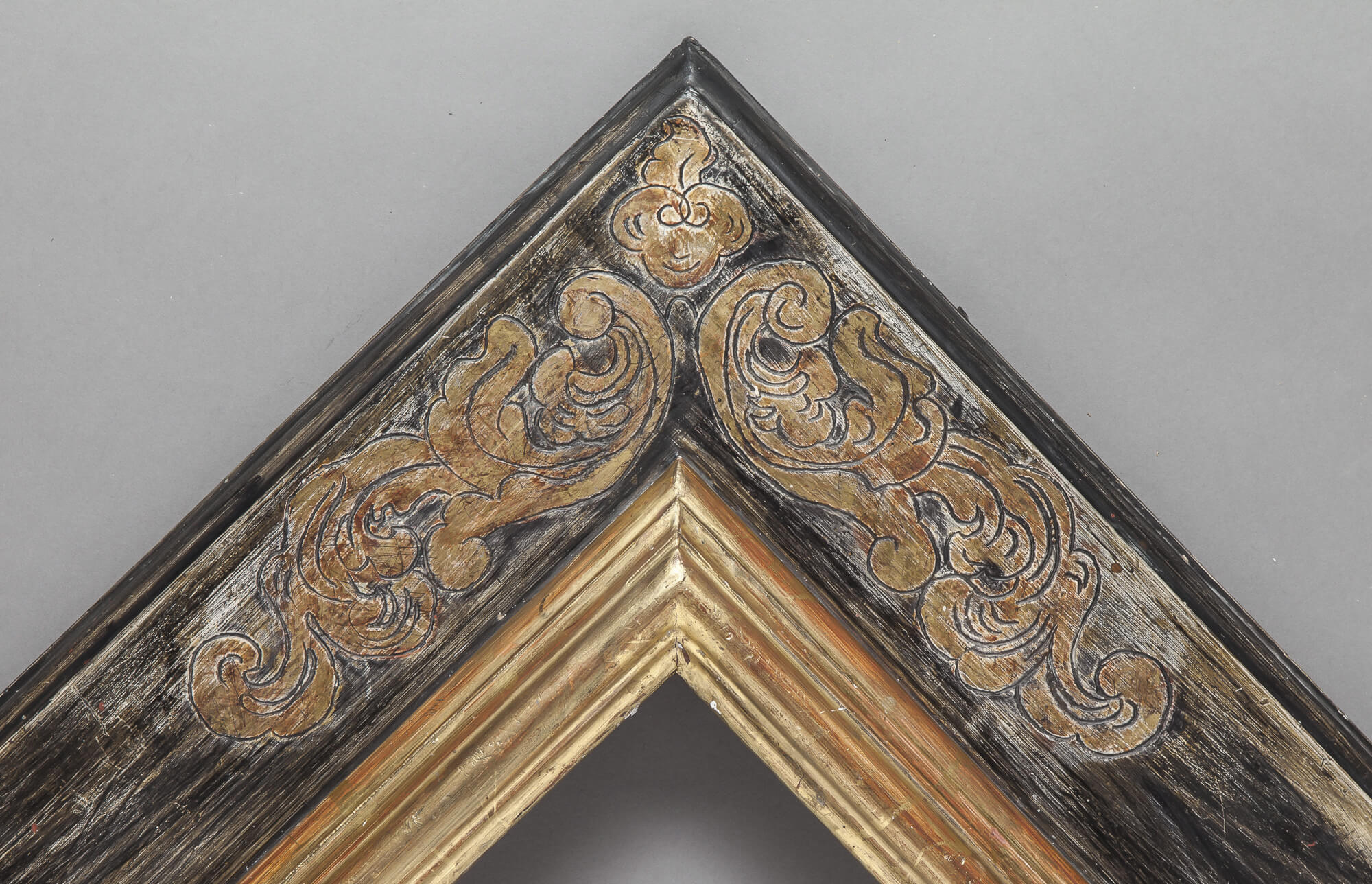 17th Century with engraved corner decorations.